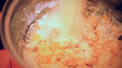 Putting flour for baking and pouring milk in bowl Stock Footage