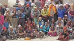 Foreign tourists and locals at the masked dance festival,Lamayuru,Ladakh,India - stock footage