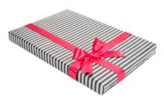Fashionable striped gift box with a pink bow Stock Photos