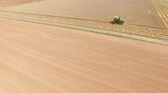 Combine harvester on a grainfield in germany. Near Cologne. June 2015 Stock Footage