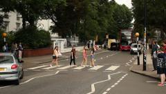 Girls crossing the street in front of Abbey Road studios, London Stock Footage