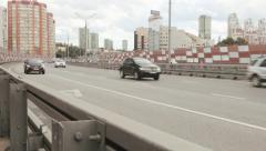 Zhivopisny cable-stayed bridge and road traffic that spans Moskva River - stock footage