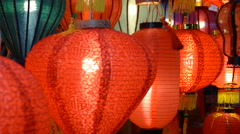 Lighted Chinese Lanterns Swaying in the Wind - stock footage