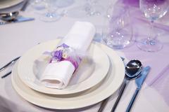 Detail of a wedding dinner setting Stock Photos