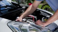 Checking broken car headlights bulb - stock footage