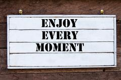Inspirational message - Enjoy Every Moment - stock photo
