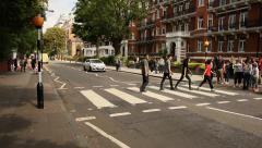 People crossing the street in front of Abbey Road studios, London Stock Footage