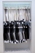 Men's vests on hangers - stock photo