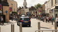 People and traffic in the streets of Greenwich, London Footage
