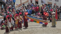 Musician and spectators at masked dance festival,Lamayuru,Ladakh,India - stock footage