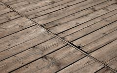 Vintage wooden panel with diagonal planks and gaps - stock illustration