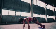 Woman doing burpees as cross fit exercise Stock Footage