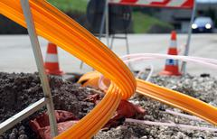 road excavation for the laying of optical fiber for high speed internet - stock photo
