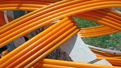 Orange pipes for fiber optic connection ADSL users - stock photo