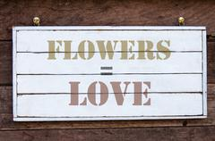 Inspirational message - Flowers Equal Love - stock photo