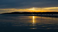 Sea Sunset in Harbour Stock Photos