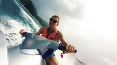 The young man riding a water bike jetski Stock Footage