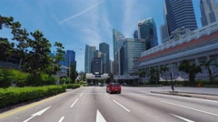 POV, driving on freeway towards business district Raffles place, Singapore. Stock Footage