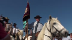 Horses in the water for the traditional feast of the Gypsies in the Camargue Stock Footage