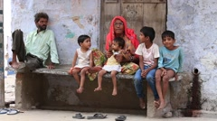 Poor Indian family sits on the street in Pushkar. India - stock footage