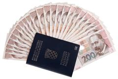 Croatian passport with Croatian money, isolated on white Stock Photos