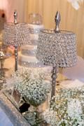 Beautiful crystal lamps decorating the table - stock photo