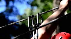 Dolly shot of Safety equipment for mountain climbing. Mountaineer woman clings t Stock Footage