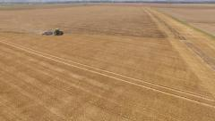 Tractor on a acre. Grubbering a field in Europe - stock footage