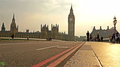 Buses, cars and pedestrians crossing Westminster Bridge in London Stock Footage