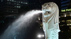 Merlion Statue / Modern Singapore Skyline at Night Stock Footage