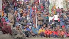 Spectators watch dancer with hat,masked dance festival,Lamayuru,Ladakh,India Stock Footage