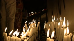 Candles and wax candles in the crypt of the church Stock Footage