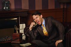 Businessman makes an important phone call. Kuvituskuvat