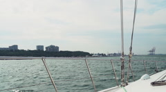 The seaport view from a sailing yacht slow motion Stock Footage