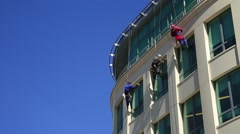 The window cleaner at an office building Stock Footage