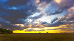 Field with  grass and  clouds. Shot in 4K 4096x2304  orange sunset Timelapse Stock Footage