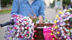 Girl florist sells floral wreaths on the street. Stock Footage