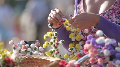 Girl florist sells floral wreaths on the street. Stock Footage