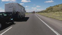 Recreational Vehicle Towing Car Driving On Interstate Freeway Stock Footage