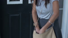 Young woman searches for keys in purse Stock Footage