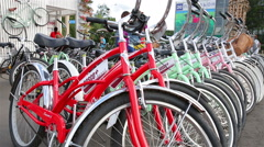 A lot of city bikes at the rental desk in the city park. Stock Footage