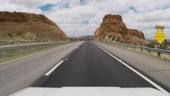 Viewpoint Vehicle Driving Interstate 40 Between Rocky Buttes Stock Footage