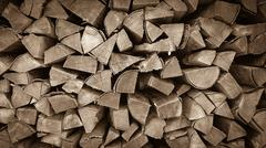 Neatly stacked wood as background - stock photo