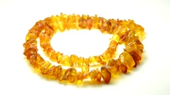 Stock Video Footage of Amber necklace on turn table