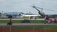 Helicopter And Historic Ford Trimotor Plane Take Off At Airshow Stock Footage
