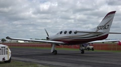 Small Private Plane On Ranway At Airport - stock footage