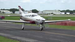 Small Private Plane Taxis On Runway At Airport - stock footage
