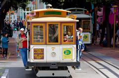 Passengers riding on Powell-Hyde line cable car in San Francisco, CA Stock Photos