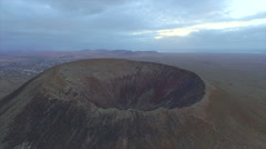 AERAL: Flying over the edge of a huge volcano crater - stock footage