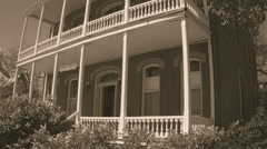 Historic Old West House With Wooden Porches- Sepia Tone - stock footage